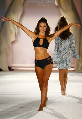supermodel: MIAMI, FL - JULY 18: A model walks runway in designer swim apparel during the Frankies Bikinis fashion show at W hotel for Miami Swim Week on July 18, 2015