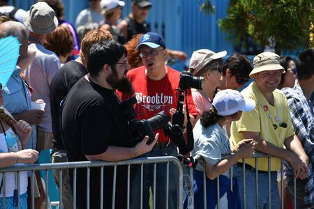 NEW YORK - JUNE 18, 2016: Press working during the 34th Annual Mermaid Parade at Coney Island, the largest art parade in the nation and a celebration of ancient mythology on June 18, 2016 in Brooklyn NY.