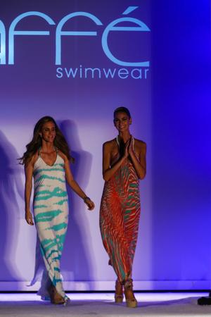to paula: MIAMI, FL - JULY 18: Designrer Paula Saavedra (L) and model walks runway during the Caffe Swimwear fashion show at W hotel for Miami Swim Week on July 18, 2015