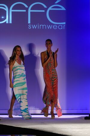 paula: MIAMI, FL - JULY 18: Designrer Paula Saavedra (L) and model walks runway during the Caffe Swimwear fashion show at W hotel for Miami Swim Week on July 18, 2015