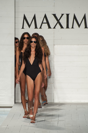 finale: MIAMI, FL - JULY 18: Models walk runway finale in designers swim apparel during the Maxim Swimwear Launch fashion show at SLS hotel on July 18, 2015