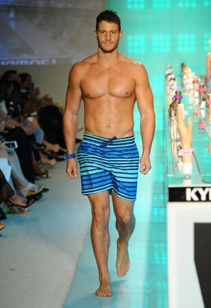 swimshorts: MIAMI, FL - JULY 15: Model walks the runway during KEBOE Spring Summer 2017 Runway accessory show at Funkshion Sunset venue on July 15, 2016 in Miami Beach, FL