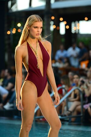 MIAMI, FL - JULY 17: Model walks the runway during Lyberthras Spring Summer 2017 Runway Show at W Hotel poolside on July 17, 2016 in Miami Beach, FL