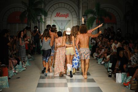 stage props: MIAMI, FL - JULY 17: Designers and Modes walk the runway during Maaji Spring Summer 2017 Runway Show at Funkshion tent on July 17, 2016 in Miami Beach, FL Editorial