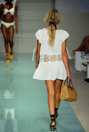 MIAMI, FL - JULY 17: Model walks the runway during For Love & Lemons Spring Summer 2017 Runway Show at Funkshion tent on July 17, 2016 in Miami Beach, FL Editorial