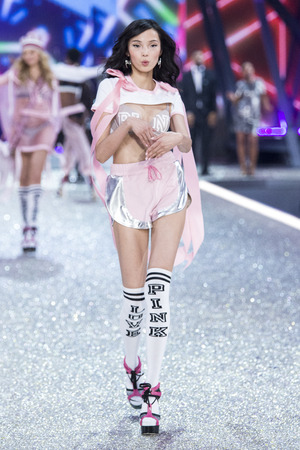 PARIS, FRANCE - NOVEMBER 30: Xiao Wen walks the runway at the Victorias Secret Fashion Show on November 30, 2016 in Paris, France.