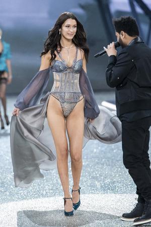 bella: PARIS, FRANCE - NOVEMBER 30: Bella Hadid walks the runway during the 2016 Victorias Secret Fashion Show on November 30, 2016 in Paris, France. Editorial