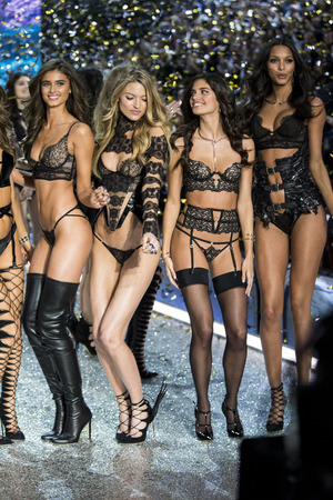 hosiery: PARIS, FRANCE - NOVEMBER 30: Models pose on the runway during the 2016 Victorias Secret Fashion Show on November 30, 2016 in Paris, France. Editorial
