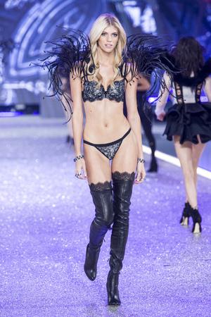 PARIS, FRANCE - NOVEMBER 30: Devon Windsor walks the runway during the 2016 Victorias Secret Fashion Show on November 30, 2016 in Paris, France.