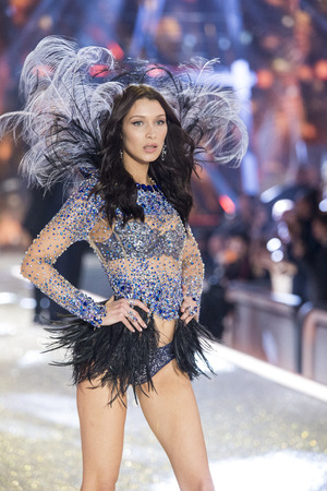 hosiery: PARIS, FRANCE - NOVEMBER 30: Bella Hadid walks the runway during the 2016 Victorias Secret Fashion Show on November 30, 2016 in Paris, France. Editorial
