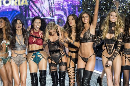 PARIS, FRANCE - NOVEMBER 30: Models pose on the runway during the 2016 Victorias Secret Fashion Show on November 30, 2016 in Paris, France. Editorial