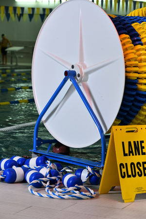 Safety ropes and buoys at the side of swimming pool
