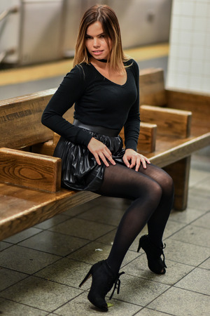 Sexy young blond model posing pretty at NYC subway. Stock Photo