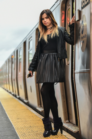 hosiery: Gorgeous stylish girl posing on the train platform in NYC Subway.