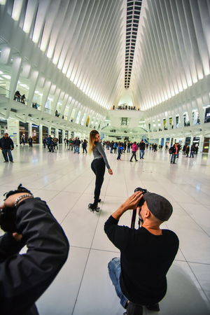behind scenes: BTS - behind the scenes photo of photographers working at the shoot at  WTC station in  NYC subway.