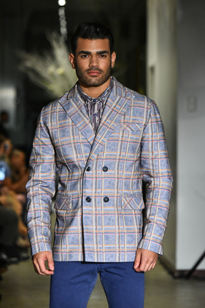 trouser: NEW YORK, NY - JANUARY 30: A model walks the runway at the ANTINOO Menswear FALL 2017 Metamorphosis Collection at the Prince George Gallery on January 30, 2017 in New York City.