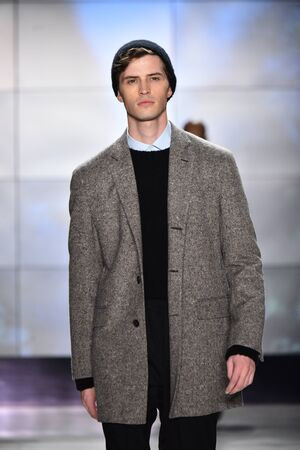 NEW YORK, NY - FEBRUARY 1: A model wears an outfit on the runway at the Deveaux fashion presentation during New York Fashion Week: Mens FW 2017 at Cadilllac House on February 1, 2017 in NYC.