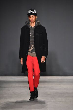 trouser: NEW YORK, NY - JANUARY 31: A model walks the runway during the Ovadia and Sons Runway show during NYFW: Mens at Skylight Clarkson North on January 31, 2017 in New York City. Editorial