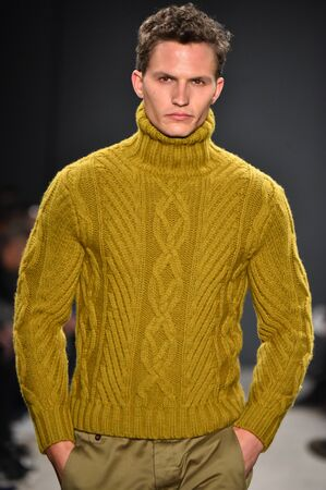 cable knit: NEW YORK, NY - FEBRUARY 01: A model walks the runway during the Todd Snyder NYFW: Mens show at Skylight Clarkson North on February 1, 2017 in New York City. Editorial