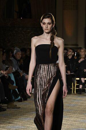 winter fashion: NEW YORK, NY - FEBRUARY 11: A model walks the runway for the Christian Siriano collection during, New York Fashion Week on February 11, 2017 in New York City.