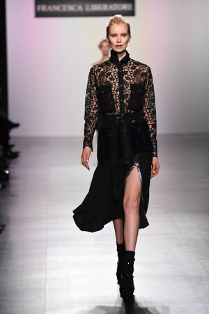 velvet dress: NEW YORK, NY - FEBRUARY 11: A model walks the runway for the Francesca Liberatore collection during, New York Fashion Week on February 11, 2017 in New York City.