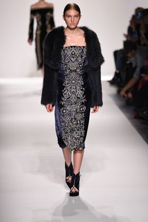 velvet dress: NEW YORK, NY - FEBRUARY 11: A model walks the runway for the Jonathan Simkhai collection during, New York Fashion Week on February 11, 2017 in New York City.
