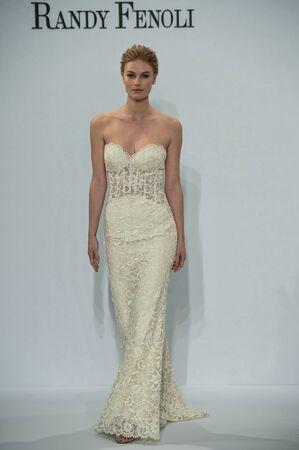 NEW YORK, NY - APRIL 20: A model walks the runway at the Randy Fenoli SpringSummer Bridal 2018 show at  Kleinfeld Hotel on April 20, 2017 in New York City.