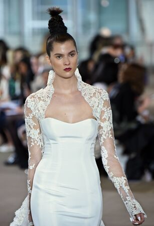 sheath: NEW YORK, NY - APRIL 21: A model walks the runway during the Ines di Santo SpringSummer 2018 bridal fashion show at The IAC Building on April 21, 2017 in New York City.