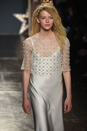 NEW YORK, NY - APRIL 21: A model walks the runway during the Jenny Packham SpringSummer 2018 bridal collection fashion show at 775 Washington Street on April 21, 2017 in New York City.