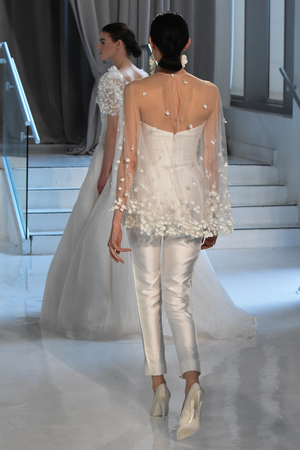 NEW YORK, NY - APRIL 20: Models walk the runway at the Peter Langer SpringSummer Bridal 2018 show on April 20, 2017 in New York City.