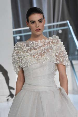 NEW YORK, NY - APRIL 20: A model walks the runway at the Peter Langer SpringSummer Bridal 2018 show on April 20, 2017 in New York City.