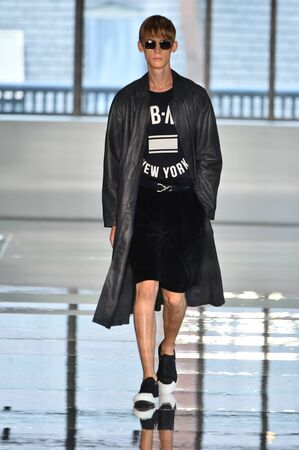 NEW YORK, NY - JULY 11: A model walks the runway at the BOSS - Hugo Boss show during NYFW Mens Spring Summer 2018 at 11 Fulton street on July 11, 2017 in New York City.