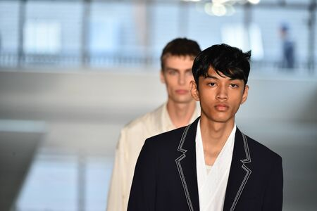 NEW YORK, NY - JULY 11: Models walk the runway finale at the BOSS - Hugo Boss show during NYFW Mens Spring Summer 2018 at 11 Fulton street on July 11, 2017 in New York City. Editorial