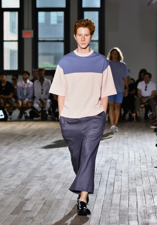 tailored: NEW YORK, NY - JULY 11: A model walks the runway during the N. Hoolywood Runway, NYFW: Mens July 2017 at West Edge on July 11, 2017 in New York City.