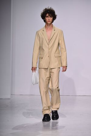 NEW YORK, NY - JULY 11: A model walks the runway at the Patrik Ervell show during NYFW: Mens July 2017 at Skylight Clarkson Sq on July 11, 2017 in New York City.