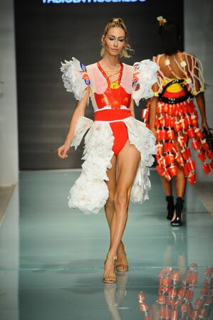 MIAMI, FL - JULY 20: A model walks the runway at McDCouture Makes A Splash At Miami Swim Week at 2100 Collins Ave. on July 20, 2017 in Miami, Florida.