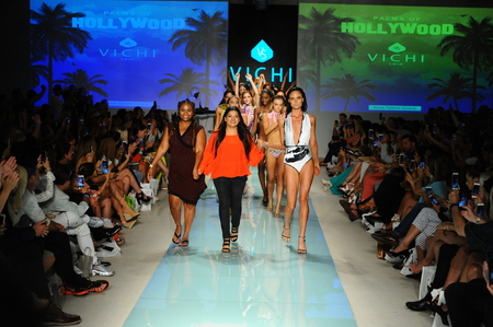 MIAMI, FL - JULY 20: Designer Monique Deptula and models walk the runway during Vichi Swim fashion show for Funkshion Miami Swim Week on July 20, 2017.