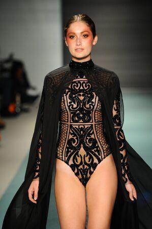 MIAMI, FL - JULY 20: A model walks the runway during Elie Madi fashion show for Funkshion Miami Swim Week on July 20, 2017.