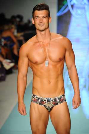 MIAMI, FL - JULY 20: A model walks the runway during Mr Tripple X  fashion show for Funkshion Miami Swim Week on July 20, 2017.