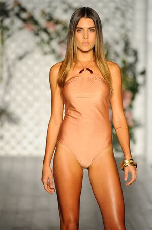 MIAMI BEACH, FL - JULY 21: A model walks the runway at the Sinesia Karol fashion show during Funkshion Swim Fashion Week at Nautilus Hotel on July 21, 2017 in Miami Beach, Florida. Editorial