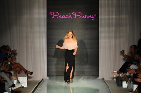 MIAMI, FL - JULY 21: Designer Angela Chittenden walks the runway at the Beach Bunny  fashion show during Funkshion Swim Fashion Week at the Funkshion Tent on July 21, 2017 in Miami Beach, Florida.