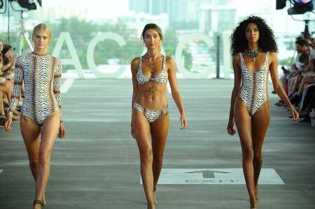 MIAMI, FL - JULY 22: Models walk the runway at Acacia fashion show during Funkshion Swim Fashion Week at 1111 Lincoln Road on July 22, 2017 in Miami, Florida.