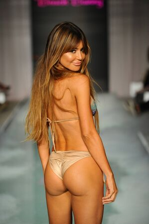 MIAMI, FL - JULY 21: A model walks the runway at the Beach Bunny  fashion show during Funkshion Swim Fashion Week at the Funkshion Tent on July 21, 2017 in Miami Beach, Florida.