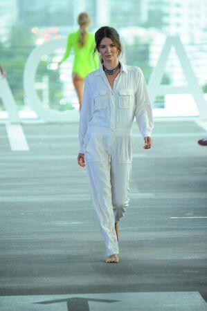 MIAMI, FL - JULY 22: A model walks the runway at Acacia fashion show during Funkshion Swim Fashion Week at 1111 Lincoln Road on July 22, 2017 in Miami, Florida.