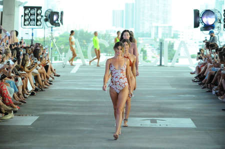 MIAMI, FL - JULY 22: Models walk the runway finale at Acacia fashion show during Funkshion Swim Fashion Week at 1111 Lincoln Road on July 22, 2017 in Miami, Florida.
