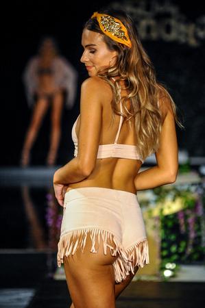 MIAMI BEACH, FL - JULY 22: A model walks the runway at the Agua Bendita fashion show during Funkshion Swim Fashion Week at Setai Hotel on July 22, 2017 in Miami Beach, Florida. Editorial