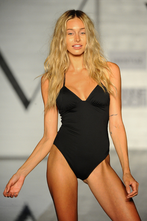 MIAMI BEACH, FL - JULY 22: A model walks the runway wearing the designer brand Demadly at the  Scandinavian Chic fashion show presented by The Perfect V during Funkshion Swim Fashion Week at Nautilus Hotel on July 22, 2017 in Miami Beach, Florida.