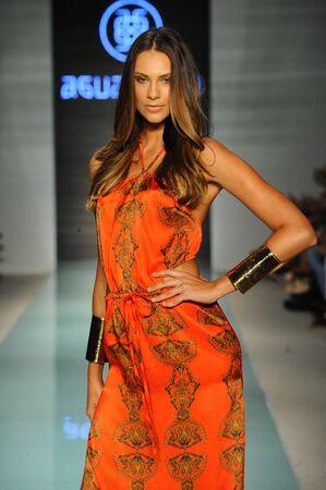 exclusively: MIAMI BEACH, FL - JULY 22: A model walks the runway at Aguaclara fashion show during Funkshion Swim Fashion Week at Funkshion Tent on July 22, 2017 in Miami Beach, Florida.