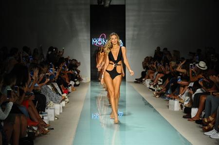 MIAMI BEACH, FL - JULY 23: Models walk the runway finale during Liliana Montoya Runway at Funkshion Swim Fashion Week at Funkshion Tent on July 23, 2017 in Miami Beach, Florida. Editorial