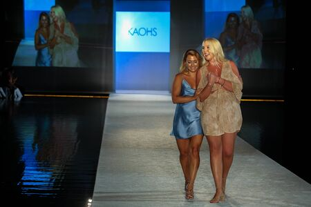 MIAMI BEACH, FL - JULY 21: Designers Tess Hamilton and Ali Hoffmann walk the runway during the SWIMMIAMI KAOHS 2018 Collection fashion show at WET Deck at W South Beach on July 21, 2017 in Miami Beach, Florida. Editorial